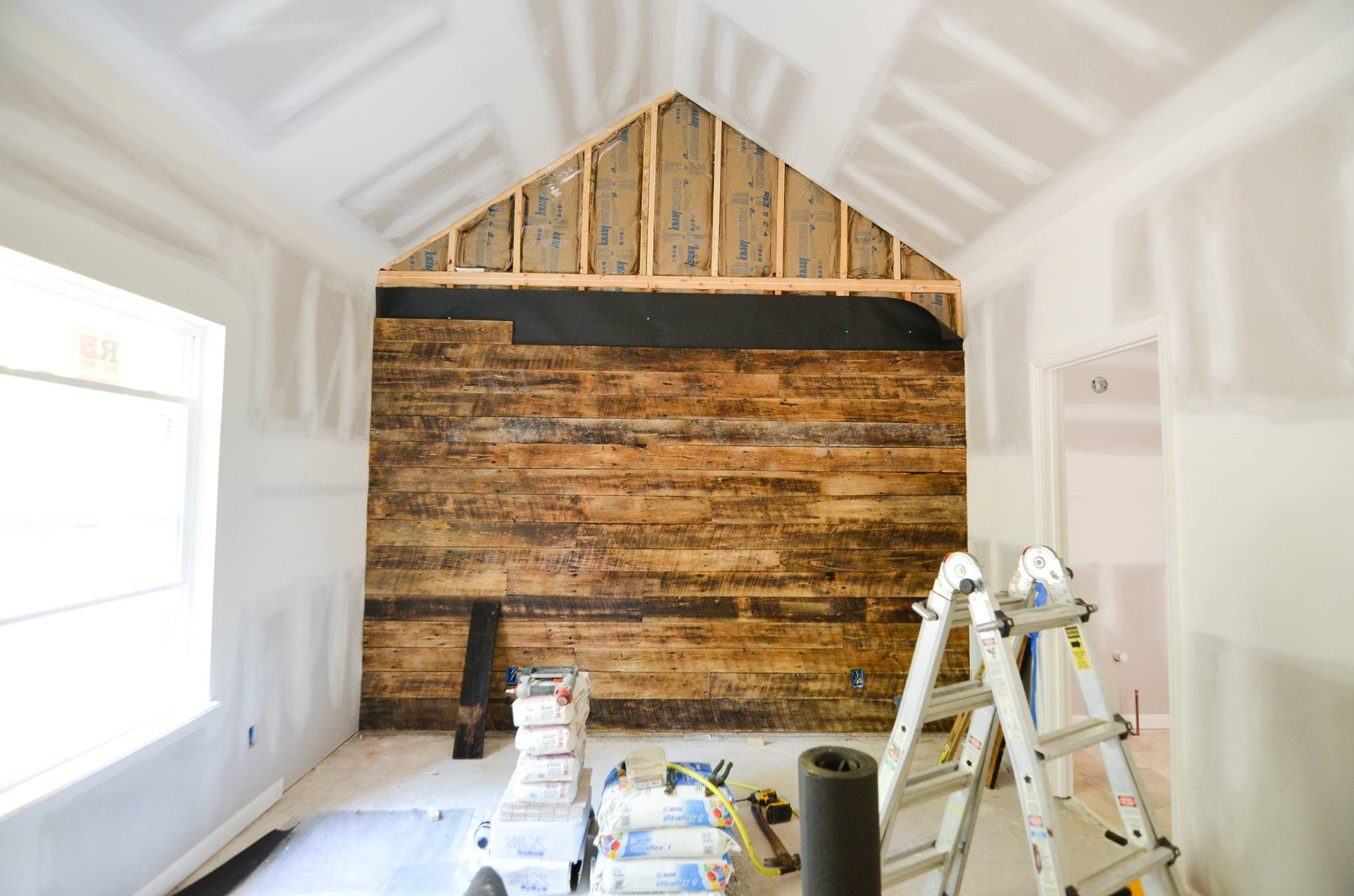 Gorgeous reclaimed wood wall being installed!